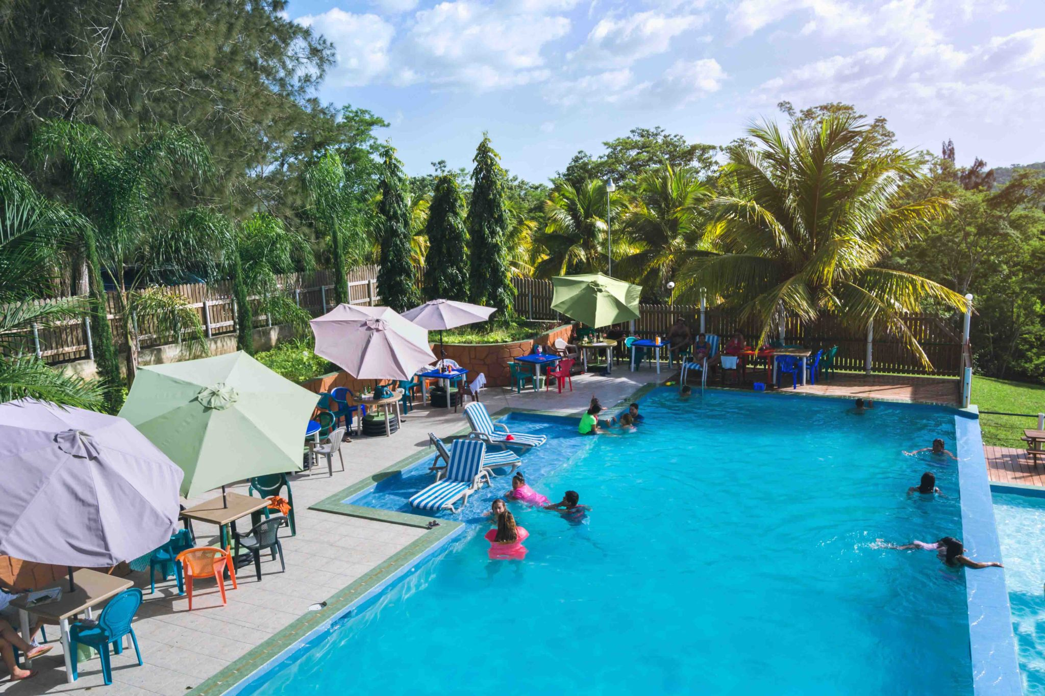 Belize-Pool-area-and-umbrellas